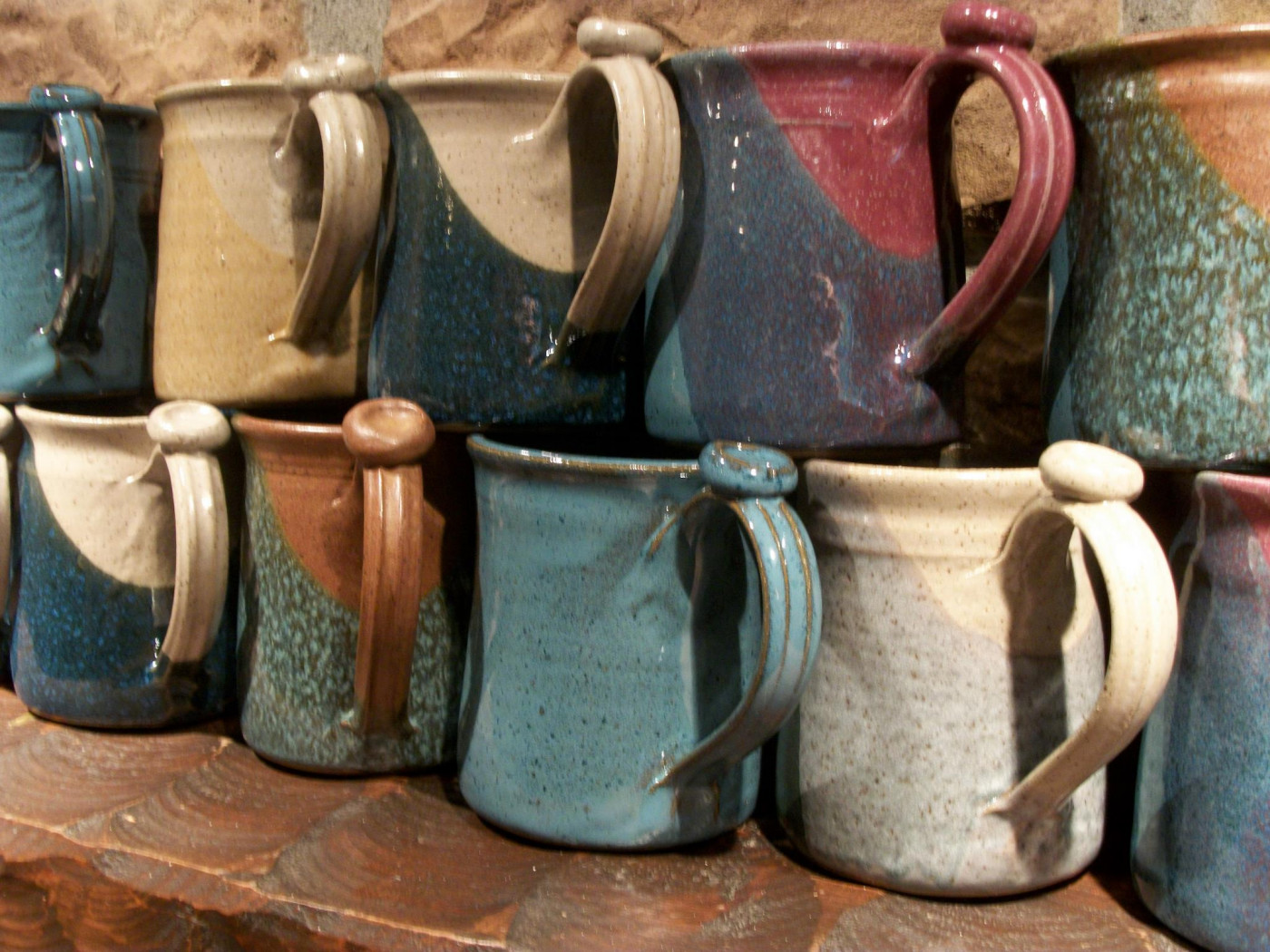 A line of mugs from the Greg Rudd Pottery Studio